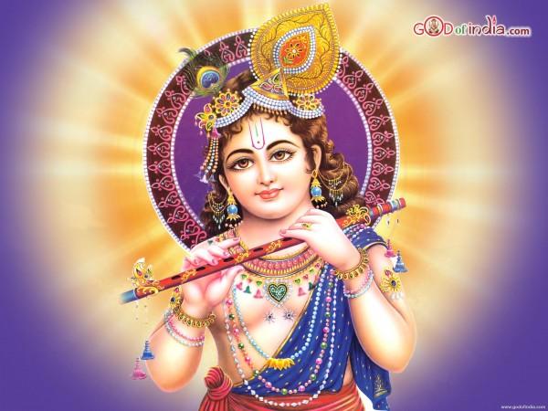 Krishna with his bansuri. (From GodofIndia.com)
